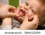 smiling toddler with first... | Shutterstock . vector #586412090