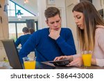 couple working together in an... | Shutterstock . vector #586443008