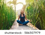 young woman practicing yoga...   Shutterstock . vector #586507979