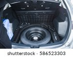 spare tire in the trunk of a...   Shutterstock . vector #586523303