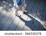 close up little girl walking on ... | Shutterstock . vector #586530278
