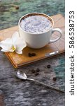 a cup of hot coffee and orchid... | Shutterstock . vector #586538753