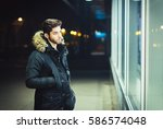 young man walking at night and... | Shutterstock . vector #586574048