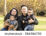 asian hispanic family posing in ...   Shutterstock . vector #586586750