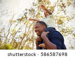 father carrying son on... | Shutterstock . vector #586587698