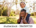 grandfather carries grandson on ... | Shutterstock . vector #586589720