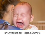 mom soothes baby. the baby is... | Shutterstock . vector #586620998