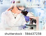 life science female researcher... | Shutterstock . vector #586637258