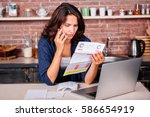 young woman sitting in the... | Shutterstock . vector #586654919
