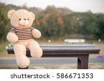 Bear Dolls On The Wooden Chair.
