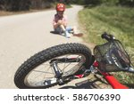 boy is lying hurt after a... | Shutterstock . vector #586706390