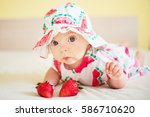 a cute baby girl dressed in a... | Shutterstock . vector #586710620