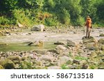Fishing In River.a Fisherman...