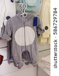 Small photo of Set of grey baby romper in a boutique