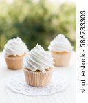 vanilla cupcakes topped with... | Shutterstock . vector #586733303