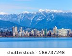 Stock photo fantastic view over ocean yacht and snow mountains in vancouver canada 586737248