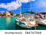 Small photo of Sailing in beautiful Greek islands - charming tranquil Aegina, Saronics