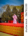 Small photo of BEIJING, CHINA - 29 JANUARY, 2017: Attending new year celebration festival in temple of earth park, lots of red decorations, music and theatre acts, traditional chinese holiday