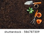 Gardening Tools On Fertile Soi...