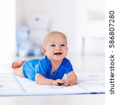 adorable baby boy learning to... | Shutterstock . vector #586807280