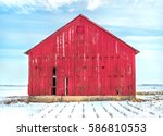 Old Red Weathered Barn In Cold...