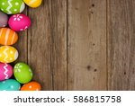 Small photo of Colorful Easter egg side border against a rustic wood background