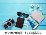 travel gear on wood table... | Shutterstock . vector #586833233