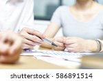 closeup shot of hands of... | Shutterstock . vector #586891514
