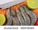 raw shrimps. food preparation. | Shutterstock . vector #586928684