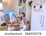 charming young woman artist... | Shutterstock . vector #586950578