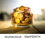 money in the glass on the... | Shutterstock . vector #586950974