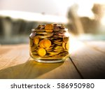 money in the glass on the... | Shutterstock . vector #586950980