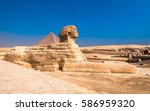 sphinx and pyramids at giza ... | Shutterstock . vector #586959320