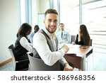 businessman with colleagues in... | Shutterstock . vector #586968356