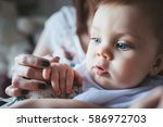 beautiful baby boy in the hands ... | Shutterstock . vector #586972703