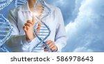 geneticist working with human... | Shutterstock . vector #586978643