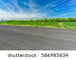 asphalt road and countryside... | Shutterstock . vector #586985834