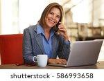 portrait of smiling business... | Shutterstock . vector #586993658