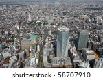 Tokyo panorama with streets, houses and skyscrapers bird's eye view. All trademarks and sign boards are blurred or erased. - stock photo