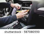 a man cleaning car interior ... | Shutterstock . vector #587080550