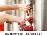 closeup of plumber hands... | Shutterstock . vector #587086814