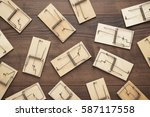 many mousetraps on the brown... | Shutterstock . vector #587117558