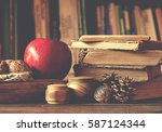 old vintage books on wooden... | Shutterstock . vector #587124344