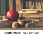 old vintage books on wooden... | Shutterstock . vector #587124350