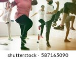 people exercising with trainer... | Shutterstock . vector #587165090