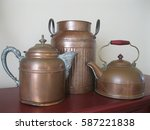 Two Old Copper Kettles And One...