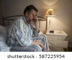 tired middle aged man waking up ... | Shutterstock . vector #587225954