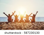 group of five happy people sits ... | Shutterstock . vector #587230130