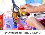 person squeeze green lemons on...   Shutterstock . vector #587243240