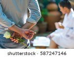 man back and hand holding white ... | Shutterstock . vector #587247146